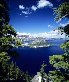 Crater Lake, Oregon | The deep blue waters that fill the caldera of the sunken volcano Mount Mazama help make Crater Lake one of America's most beautiful lakes. The deep blue waters are almost crystal clear thanks to the fact that there are no incoming streams or rivers to make the water turbid. Crater Lake, located in Southern Oregon, is also the deepest lake in the United States, plunging to depths of 1,943 feet, with sunlight extending 400 feet down.