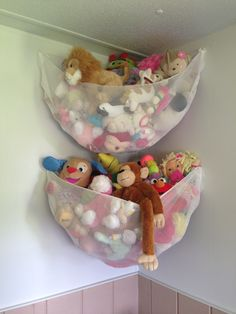2.5 yards of net fabric from Jo Ann's cut in half . 6 hooks from dollar store ($1 per pack if 10). Took me maybe 10 min at most. Finally!! A place for all those stuffed animals!!!