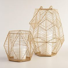 With its contemporary geometric design welded entirely by hand, our gold wire hurricane candleholder casts a retro-modern glow on any decor.