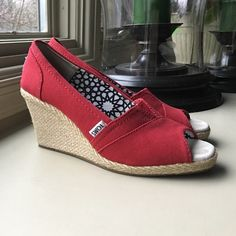 Tom's red canvas women's wedges size 7 1/2 Enjoy day tonight comfort, from working in the office to dancing under the stars. Heel height is 3 1/4 inches. Tom's classic suede insole with rubber cushion for comfort. Soft suede heel insert for added comfort. Durable solid rubber outsole with signature 1 for 1 Tom's message. TOMS Shoes Heels