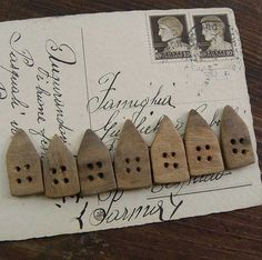7 Little houses walnut wood buttons. via Etsy.