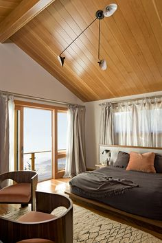 A king size platform bed, a magnificent peaked maple ceiling & a great view of the water outside combine to make this bedroom a sanctuary.