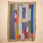 One Of A Kind Kalpana Quilted Throw-just right to curl up with a good book on the couch with.