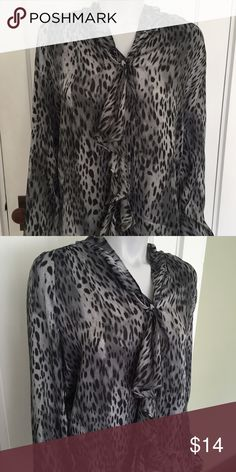 New York and Company gray patterned blouse Super cute top with leopard pattern. Nice fabric detail in the front. Long sleeve shirt is great for work or worn casual. New York & Company Tops Blouses