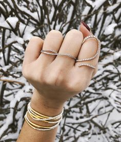 Featuring our Diamond two finger wave & open lace ring both in 18k pink gold. And a stack of Girl from Ipanema silver bracelets. By Jugar N Spice jewelry