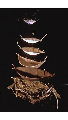 Catherine nash. Nesting BoatsCast HMPaper of varied fibers: cedar bark, torch ginger grass,gampi and kozo fibers, branches, straw. Top two boats
