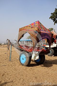 Photo about A decorated colorful camel cart sits in the deserts of Rajasthan waiting for the next caravan. Image of colorful, cart, deserts - 71074197 Editorial Photography, Camel, Waiting, Deserts, India, Colorful, Image, Camper, Postres