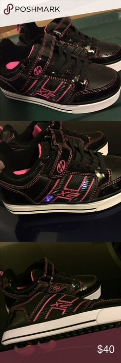 Heely's Roller Shoes Girl's size 4Y black and pink Heely's' roller shoes. These were never used. Sorry but no longer have box. Heelys Shoes Sneakers