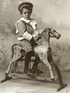Vintage Photo of a Boy on his Dappled Painted Rocking Horse.