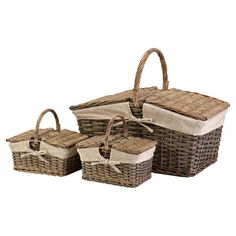 Tote picnic essentials in timeless style with these nesting baskets, featuring woven willow styling, classic fabric inserts, and bow details.