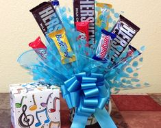 This music notes candy bouquet is the perfect gift for that musician in your life.Enjoy the Music Notes Mug long after the candy is gone. Candy Bouquet Diy, Diy Bouquet, Chocolate Flowers, Chocolate Bouquet, Balloon Gift, The Balloon, Congratulations Balloons, Graduation Balloons, Bubble Balloons