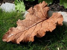 Cement Leaf Tutorial. I really like how this decorative leaf looks. You could reinforce with wire mesh, mix in color, or paint the concrete, and also shape the leaf in a way that holds water, and create an on-the-ground, garden bird bath. by cindy