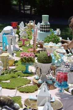 Gorgeous table settings at an Alice in Wonderland birthday party! See more party ideas at CatchMyParty.com!