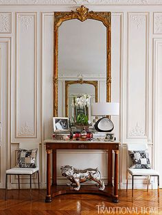 We get a chuckle from the silver bulldog. Placed beneath the console table it adds an element of surprise in this Paris apartment. http://www.traditionalhome.com/design/beautiful-homes/colorful-and-romantic-paris-apartment - Traditional Home ®/ Photo: Francis Hammond / Design: Eric Lysdahl