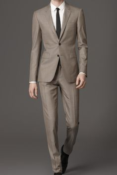 Featuring a half-canvas construction, this suit's rich wool-silk blend material isjust the right side of shiny when the sun hits it and the light fabric ensure you most definitely won't be. £1,495. burberry.com