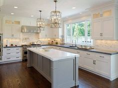 White Kitchen Cabinets off white kitchen with grey expo quartz countertop. | home decor