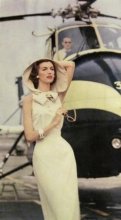 Model wearing a sleeveless dress with a hood, 1950s.