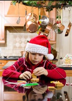 cute boy making gingerbread house for christmas. - Cute boy making gingerbread house for christmas while in the kitchen, Model: Josh Chapman