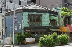 Early-20th-Century Architecture in Tsukiji (Japan)The Yuasa merchant house in Tsukiji, in the modern kanban kenchiku, or signboard architecture style. #refinery29 http://www.refinery29.com/2015/11/97540/world-monuments-foundation-endangered-watch-list-2015#slide-31