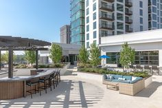 In addition to a pool, lush landscaping, and ample seating, the rooftop courtyard at AMLI 3464's luxury apartments is also home to a bar.