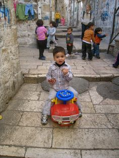 babies playing in the Muslim quarter of the Old City, Jerusalem