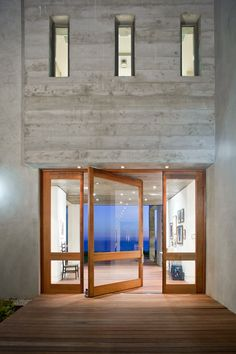 Pivoting door of the impressive 10,000 square foot Birdview residence. It was significantly remodeled by architect Douglas W. Burdge and boosts amazing views of the Pacific. The estate is located on the bluffs above Point Dume State Beach in Malibu, California, where the view often allows for gray whale sightings during migration~