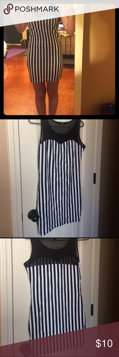 Brand new boutique dress size small This is a brand new without tags dress from a boutique brand. It would make a perfect referee Halloween costume! It's cute on but doesn't fit me definitely fits a size small as I'm an xsmall. Only worn once for the picture and then immediately taken off botique Dresses