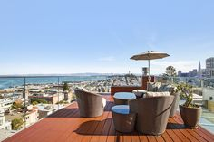 A private deck with sweeping panoramas of the North Bay, Alcatraz, Coit Tower and the Financial District skyline are enjoyed from this luxury condo in Russian Hill .