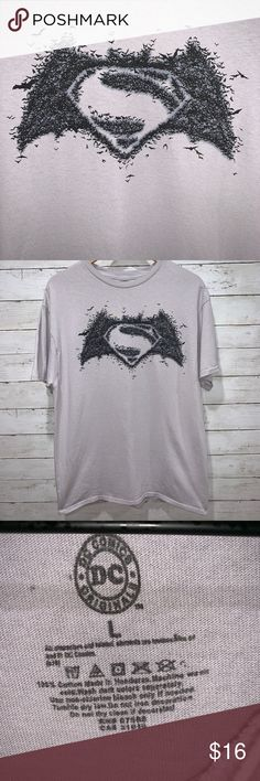 DC Comics Superman Tee Dc Comic Superman Tee  Features Bats surrounding Superman logo Size: L  Condition: Used Like New Condition. No stains or damage.  *Pet and Smoke Free Home* Batman Superman DC Comics Shirts Tees - Short Sleeve
