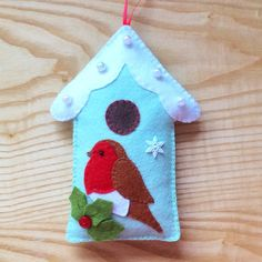 Robin and Bird House Ornament PDF Pattern I making this adorable felt robin and bird house ornament because it is easy to sew and fun to make using the applique technique. This ornament will make the perfect gift for someone special or look gorgeous on your tree or anywhere in your home during the festive season. PLEASE NOTE: This is not a finished item and you will not receive the finished ornament or supplies in the post. ****************************************** You will receive a mat...