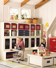 Pottery Barn playroom ideas - love the combo of tin buckets, red boxes and chalkboard fronted cupboards to fill the storage cubes