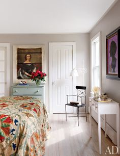 The master bedroom features works by Julian Schnabel (left) and McDermott & McGough.