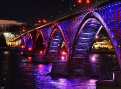 The International Peace Bridge, which connects Canada and the United States, glows with the colors of the French flag