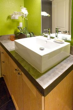 Chrome Fixtures · Concrete Countertop · Glass Knobs · Maple Cabinets ·  Modern · Shaker Style