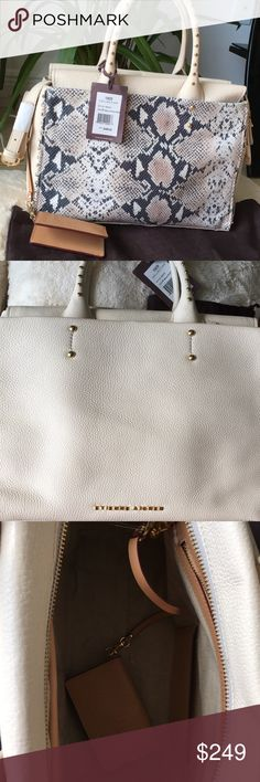 Genuine EA Forester Collection leather handbag Very rare, stunning cream leather with grey, mauve & white snake embossed front. Lots of pockets - 2 large exterior slides, 1 interior zipper, 1 large interior w/magnetic clips and 2 small slides. Bag includes optional shoulder strap and card wallet with clasp hook attachment. The entire bag is decorated with gold hardware & embellishments. Stunning. Measures - 13X9X6 with 6 in handle drop. New with tags, orig packaging, dust bag. Smoke free…