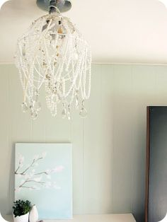 pearl and crystal adorned light fixture -I have so many vintage, broken necklaces I could do this with! And it beats keeping them tangled up in a shoebox <3