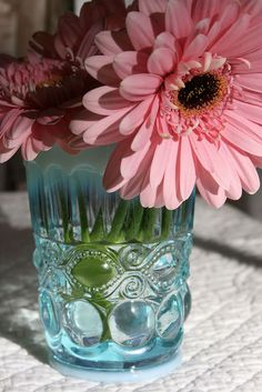 pink flowers in blue glass from Anthropologie