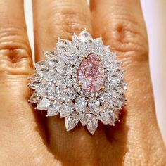 3.01ct pink diamond. [That ring looks very uncomfortable to wear. But I do like the combination of pink and white diamonds.]