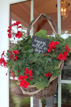 Talk of the House basket of geraniums on door