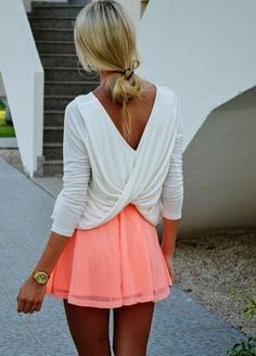 Beautiful mini dress with a fancy back! Love the pop of coral on the skirt