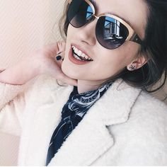 @maria.miks wears a pair of ESCADA sunglasses