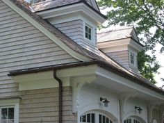 Shingle style garage with dormers. Carriage House Garage Doors, Garage House Plans, Dream Home Design, House Design, Colonial Style Homes, Charming House, Exterior Doors, Residential Architecture, Architecture Details