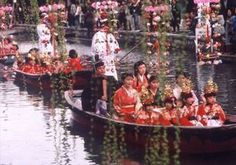 Hina Matsuri or Doll Festival is a time in March when Japanese celebrate their daughters. Here you can see a water parade held in Yanagawa City Fukuoka Prefecture Japan. Pretty girls all dressed up with a Shinto Priest protecting them. GORGEOUS!