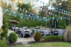 More with the pennant garland strung high above the party. Festive! 50th birthday decoration ideas