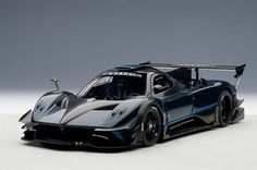 "Pagani Zonda Revolucion 1:18 Scale Diecast Car in Blue / Black Carbon Fiber by AUTOart 78273 AUTOart 78273. This 1:18 scale diecast car from AUTOart's Signature Series features opening doors and removable front end and rear engine cover. Pagani unveiled the final version of the Zonda, called Zonda Revolución to clients and family members during ""Vanishing Point 2013"", the International Pagani gathering. The 6.0-liter V12 now develops an output of 800 hp and 540 lbf·ft of torque."