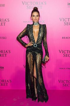 <p>The Brazilian supermodel wore a sheer and lace black gown with a plunging neckline and a high slit. She accessorized with a matching choker and styled her hair in a tight, high bun. <em>(Photo: Getty Images)</em> </p>