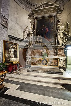 The right aisle of church of Santa Maria del Popolo in Piazza del Popolo in Rome, Italy. Some bench for the prayer of the faithful.