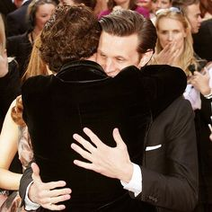 Benedict Cumberbatch & Matt Smith - Sherlock hugging the Doctor. :)  (Ben looks like he gives amazing hugs.)