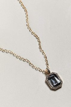 001 Luxe necklace from Riakoob featuring black stone pendant with a slight sheen surrounded by cubic zirconia stones and hung from a brass chain with adjustable lobster clasp closure. Stone Necklace, Pendant Necklace, Pendant Design, Brass Chain, Stone Pendants, Mens Fashion, Lobster Clasp, Stones, Moda Masculina