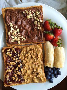 Chocolate cashew butter, peanut butter and raspberry jam, honey nut crunch granola, berries and banana